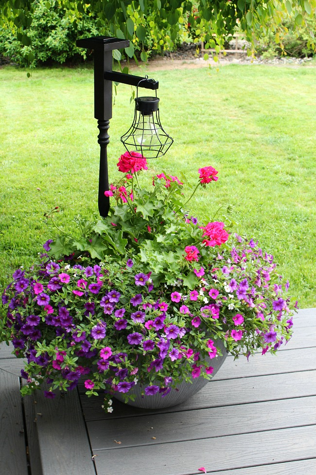 Outdoor lighting Easy DIY outdoor hanging lantern in a flower planter.