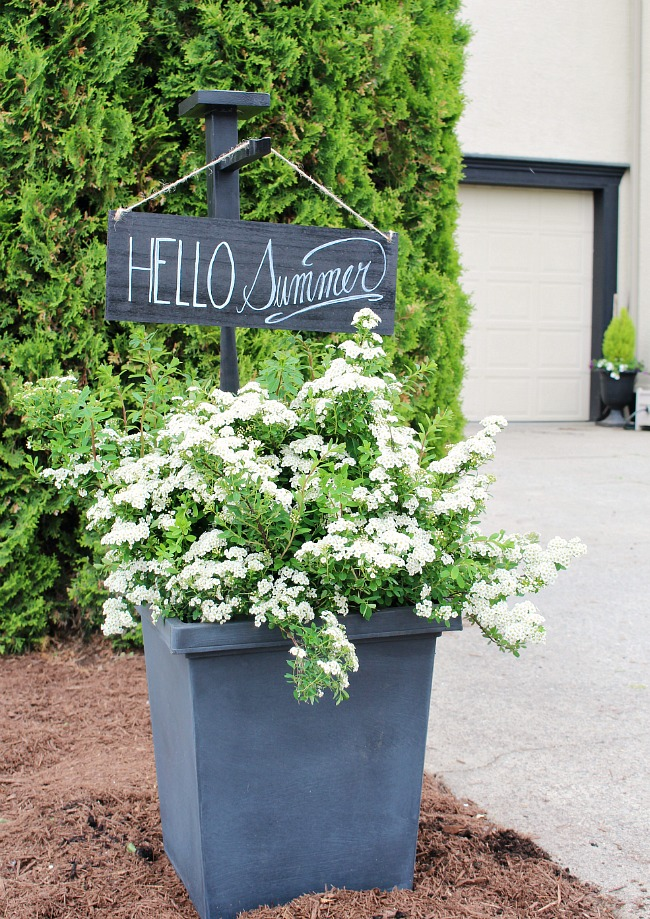 "Outdoor planter with wooden holder and outdoor sign. ""Hello Summer"""