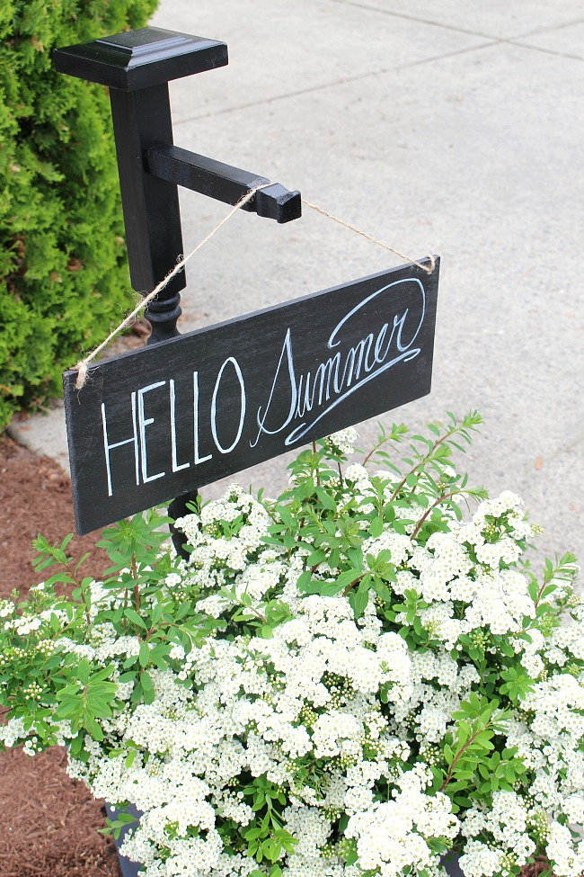 Flower planter with DIY outdoor sign and holder.