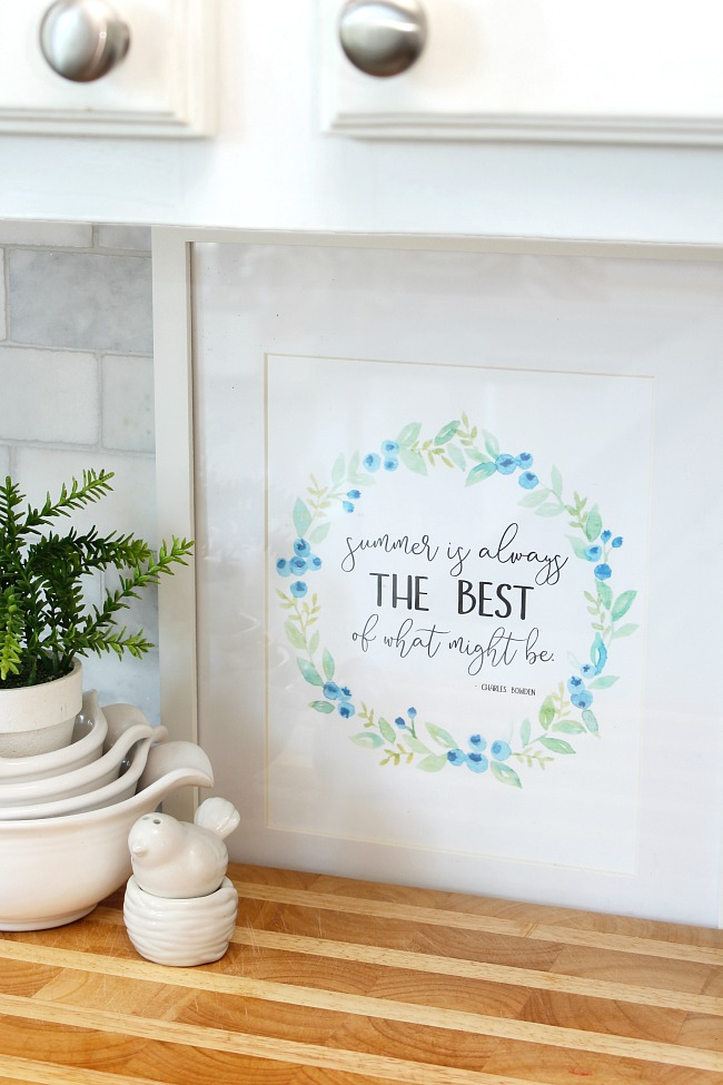 "Free summer printable - ""summer is always the best of what might be."" - with a pretty blueberry wreath surrounding the quote."