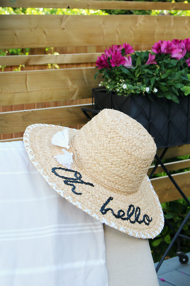 Kate Spade straw hat with embroidery.