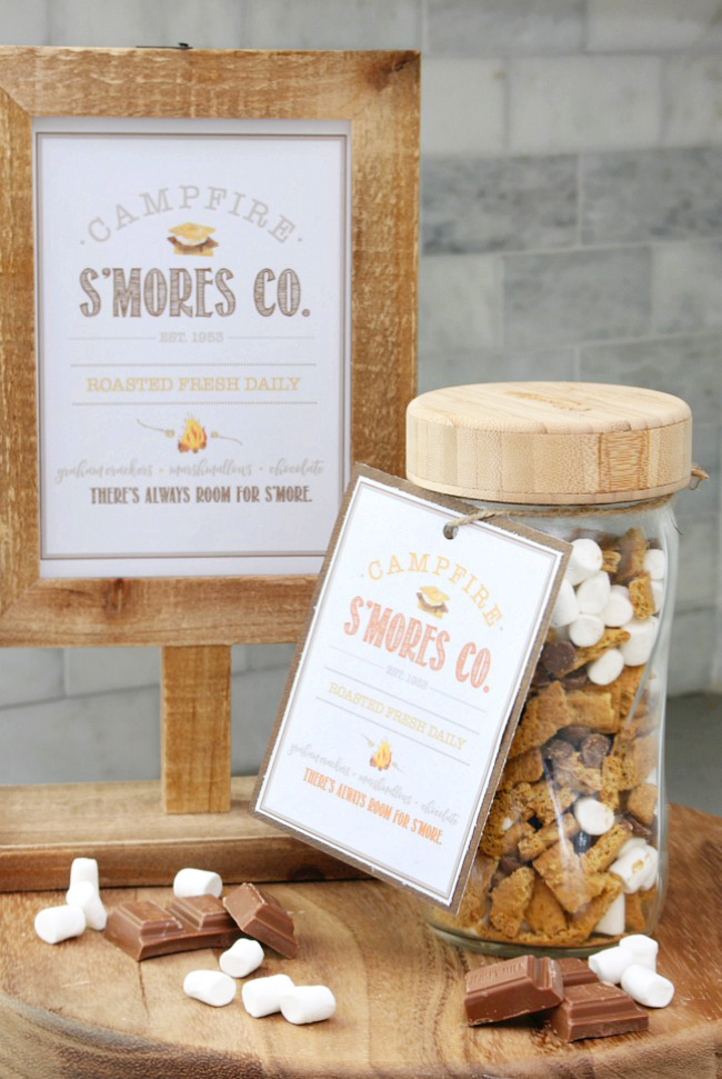 Campfire S'mores Co. printable in a wooden frame with a mason jar of s'mores mix.