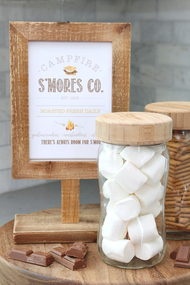 Campfire S'mores Co. free summer printable with mason jars filled with s'mores ingredients.