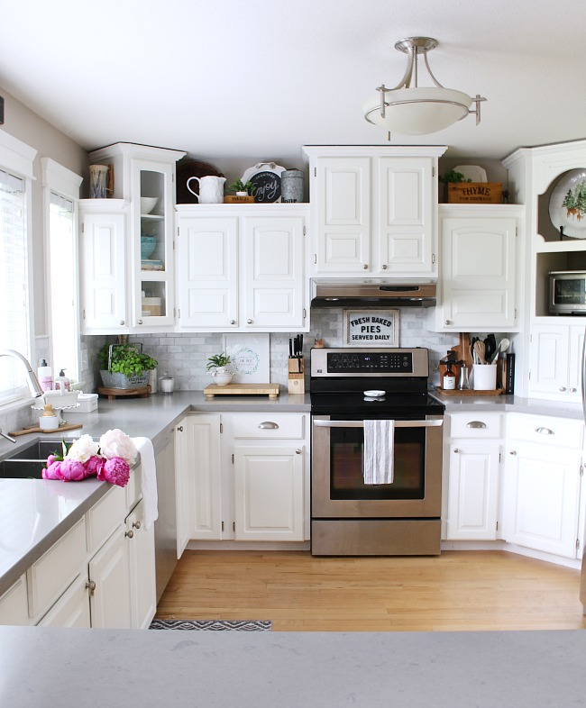 Summer Kitchen Decorating Ideas. White farmhouse style kitchen decorated for summer.