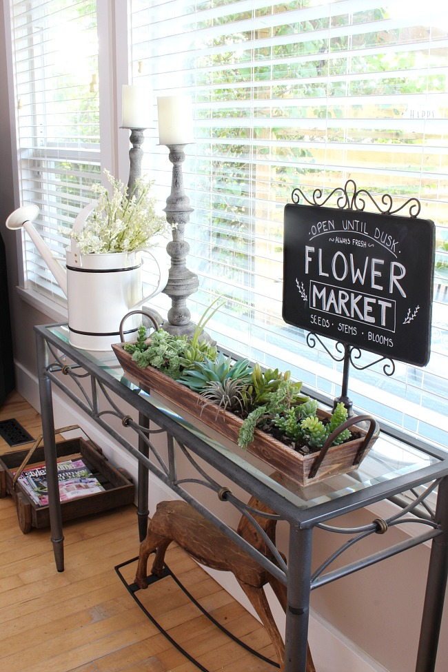 Summer vignette with flower market chalkboard and faux succulents.