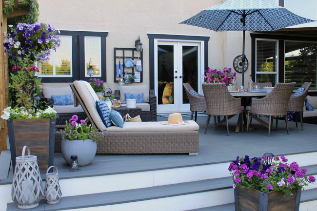 Beautiful summer patio with resin wicker furniture and Trex decking.