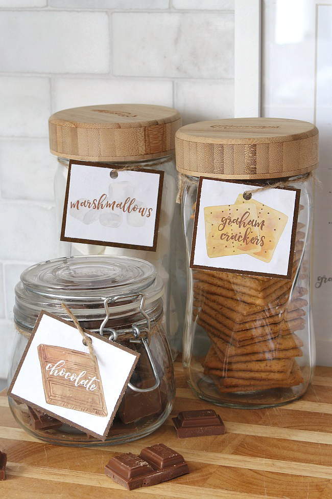Free s'mores ingredient labels for mason jars - chocolate, marshmallows, and graham crackers.