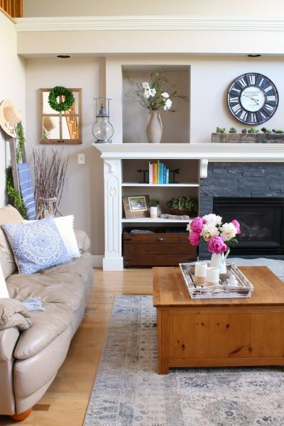 Pretty farmhouse style family room with pink peonies.