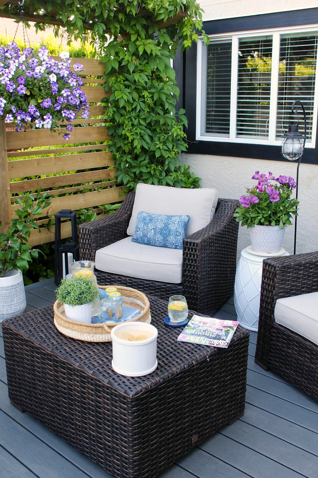 Resin wicker patio furniture on a summer patio.