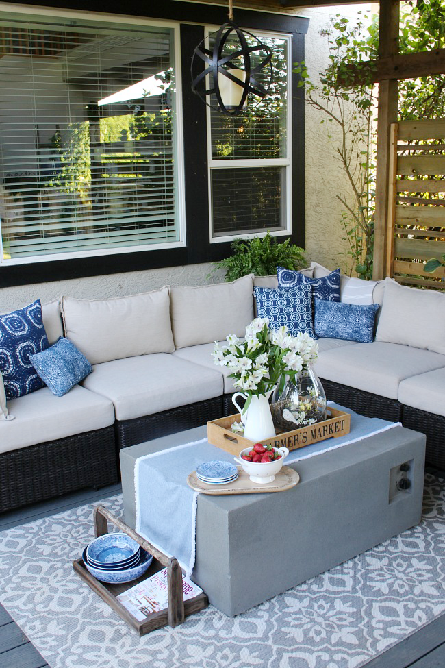 Covered Patio With Outdoor Sofa And Fire Table