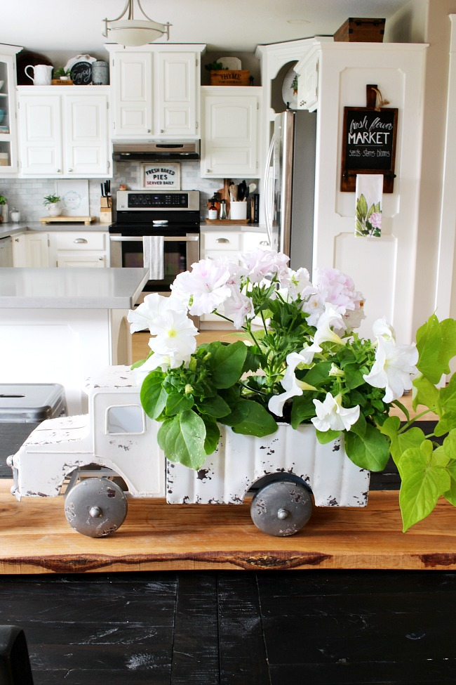 Vintage truck flower planter used as a centerpiece on a kitchen table.