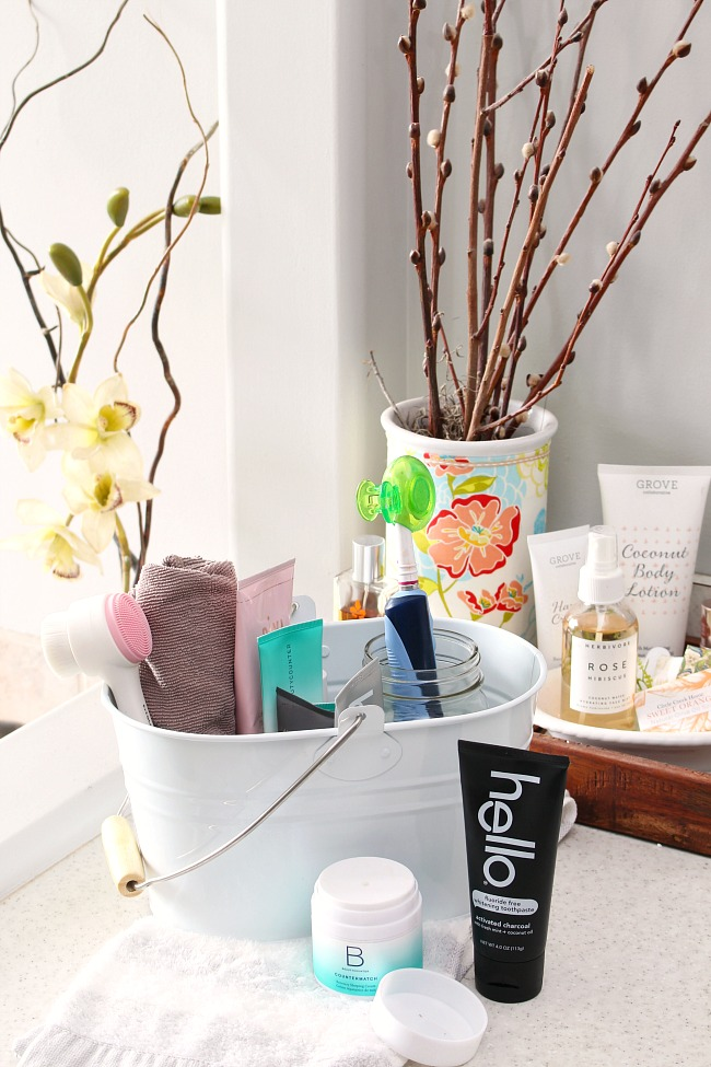 How to Get Organized with a Cleaning Caddy. White cleaning caddy from Grove Collaborative holding a variety of natural beauty products.