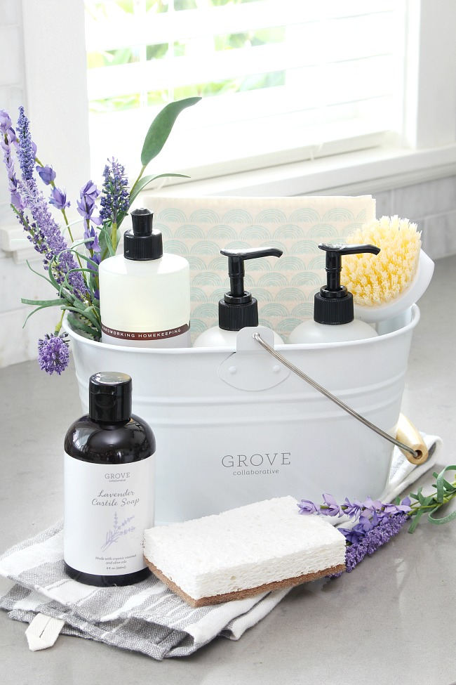 How to Use a caddy to get organized. White cleaning caddy with Mrs. Meyers cleaning products in lavender and some lavender castille soap from Grove Collaborative.