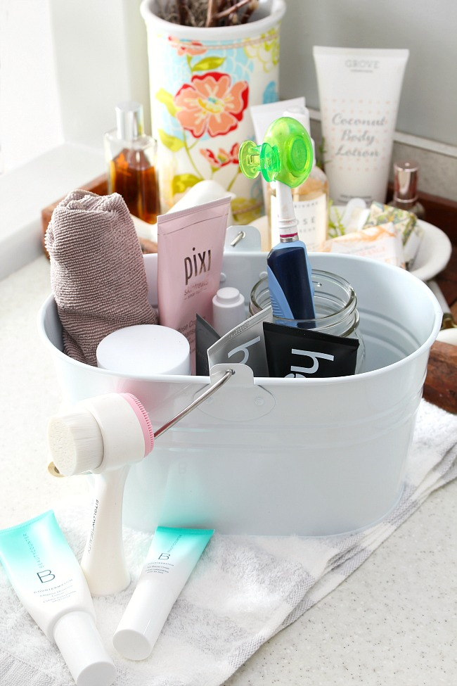 How to Use a Caddy to Get Organized. White cleaning caddy from Grove Collaborative holding a variety of natural beauty products.