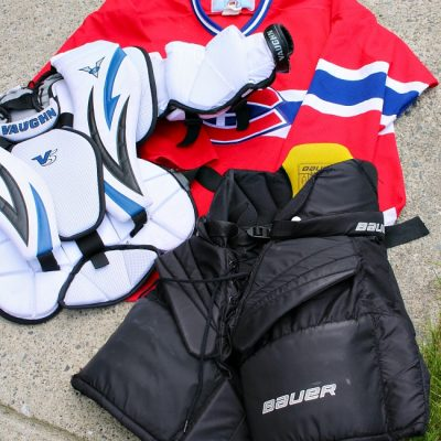How to clean sports gear. Variety of hockey equipment waiting for cleaning.
