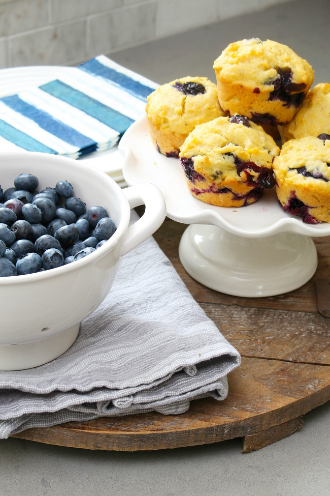 Blueberry muffins and bowl of fresh blueberries.