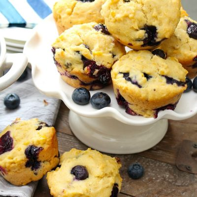 Blueberry Cornmeal Muffin Recipe. Cornmeal blueberry muffins on a pie plate.