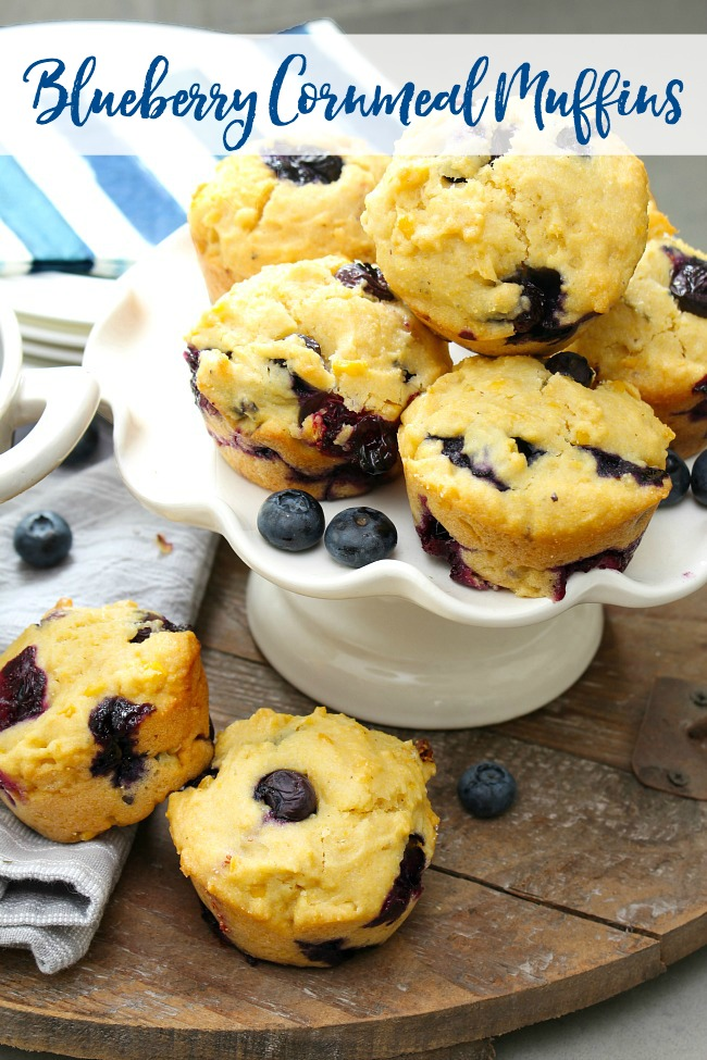 Blueberry Cornmeal Muffins with fresh blueberries.