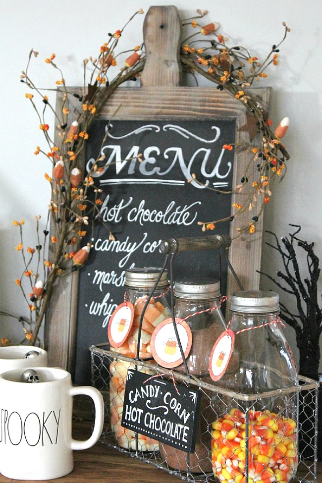 Halloween Hot Chocolate bar with free printable labels for the jars and chalkboard sign.
