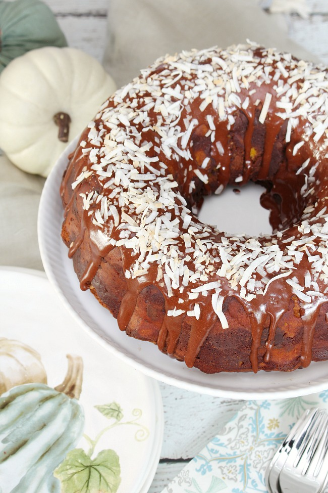 Chocolate coconut pumpkin bundt cake with a delicious chocolate glaze and topped with toasted coconut.