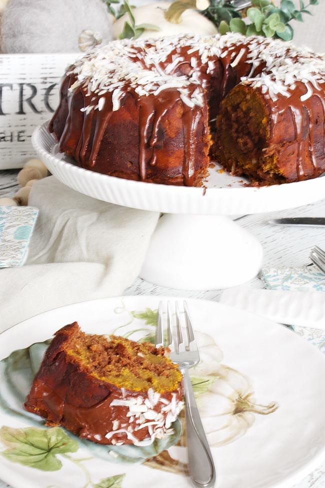 Chocolate coconut pumpkin bundt cake served on a cake plate.
