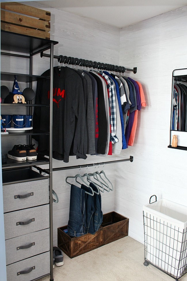 Awesome closet organizer system with a mix of open shelving and closed drawer space for storage. Double clothes rods for extra storage.