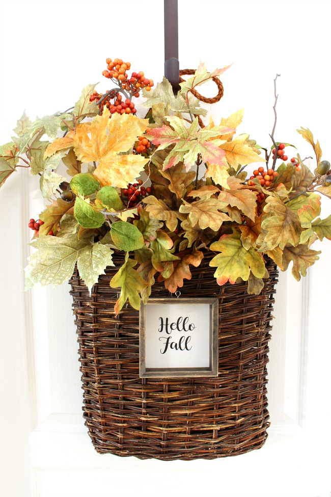 Pretty fall basket wreath. Woven wicker basket filled with beautiful fall leaves and mini twinkle lights.