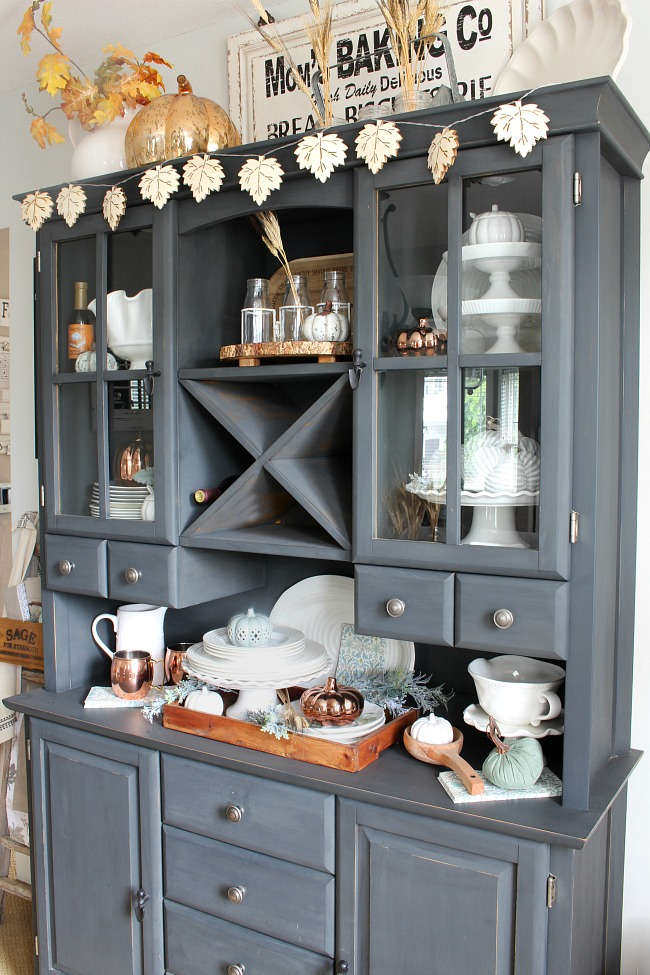 Buffet and hutch painted in Annie Sloan graphite chalk paint. Decorated for fall with white kitchenware and neutral fall colors.