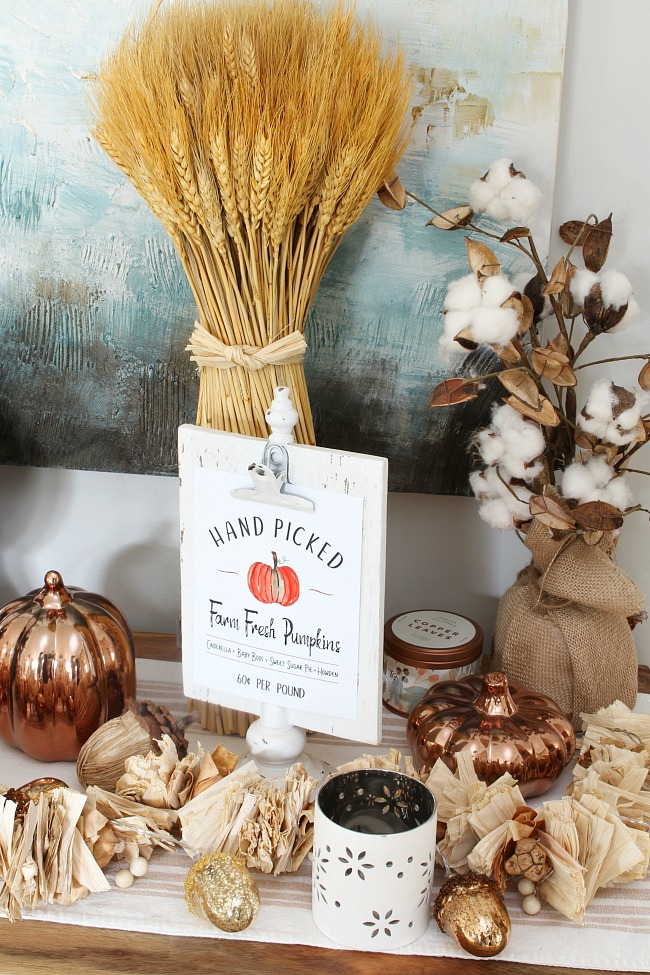Hand picked farm fresh pumpkins printable on a sideboard decorated for fall.