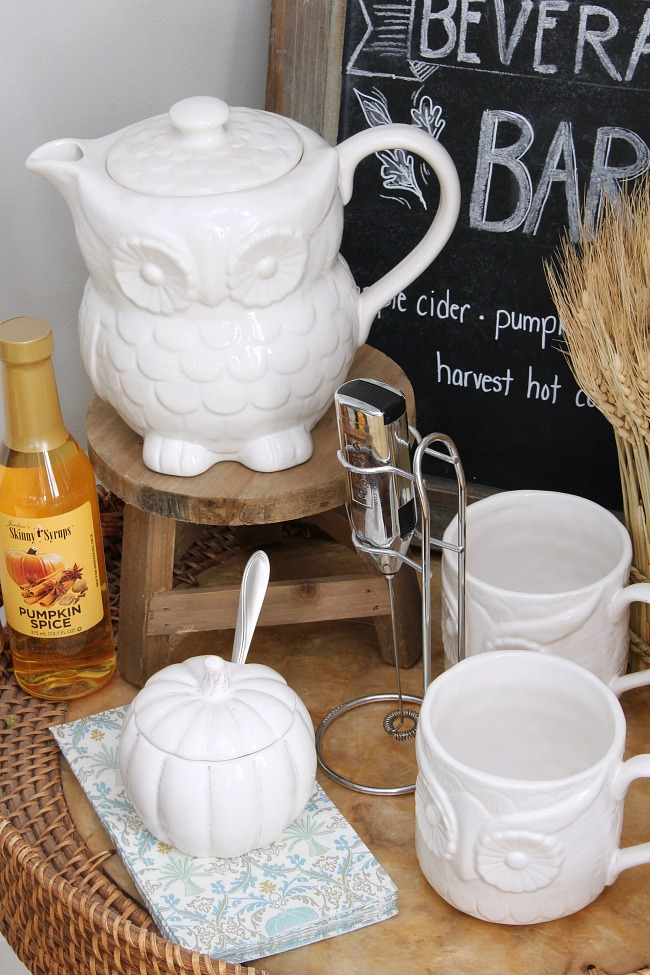 White ceramic owl tea pot set in a fall hot beverage bar.