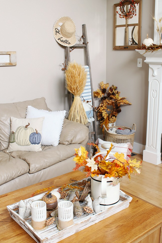 Cozy fall family room decorated for fall with traditional fall colors using lots of natural elements.