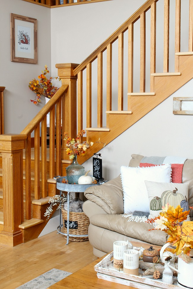 Fall family room with oak staircase decorated for fall.