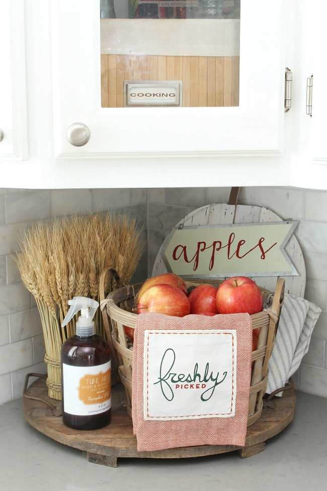 Wood basket filled with apples for fall kitchen decor.