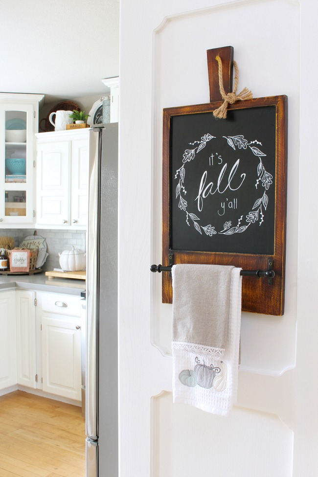 Fall chalkboard art in a white kitchen decorated for fall.
