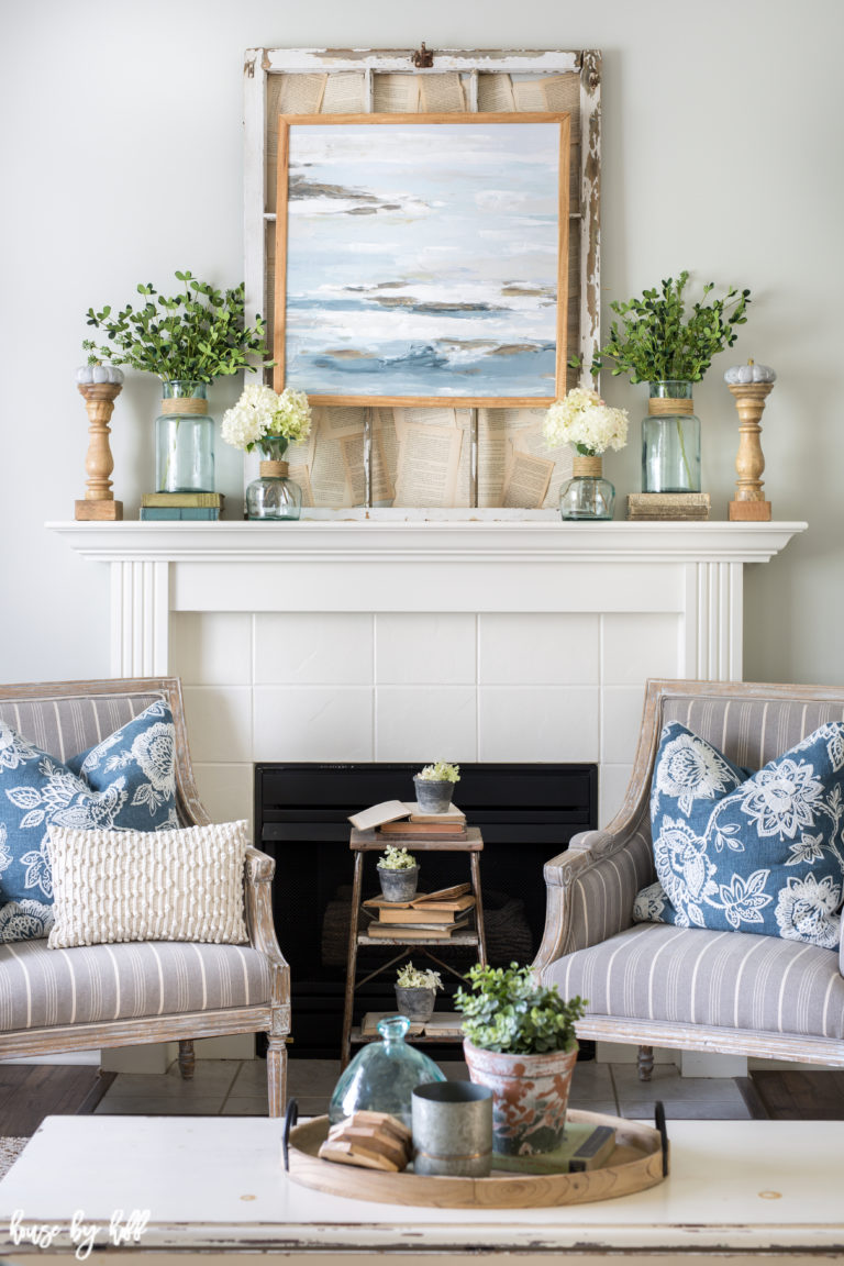 Fall mantel with blues and greens.