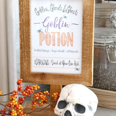 Goblin potion Halloween printable in a wooden frame.
