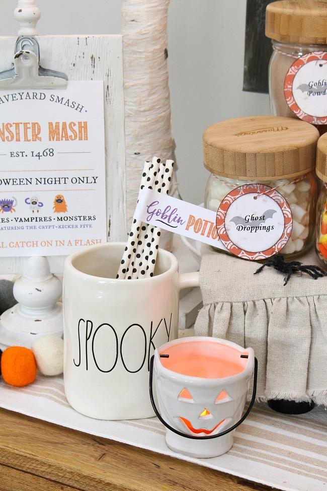 Rae Dunn Halloween mugs and other fun Halloween decor for a Halloween hot chocolate bar.