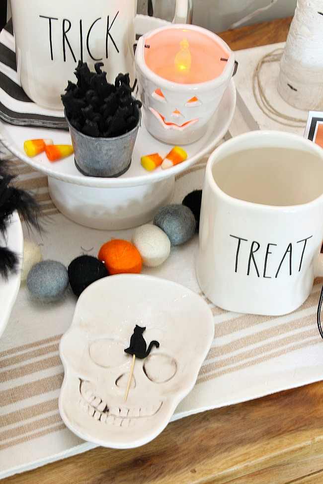 Rae Dunn mugs and cute black cat toothpicks to add to a Halloween treat bar.