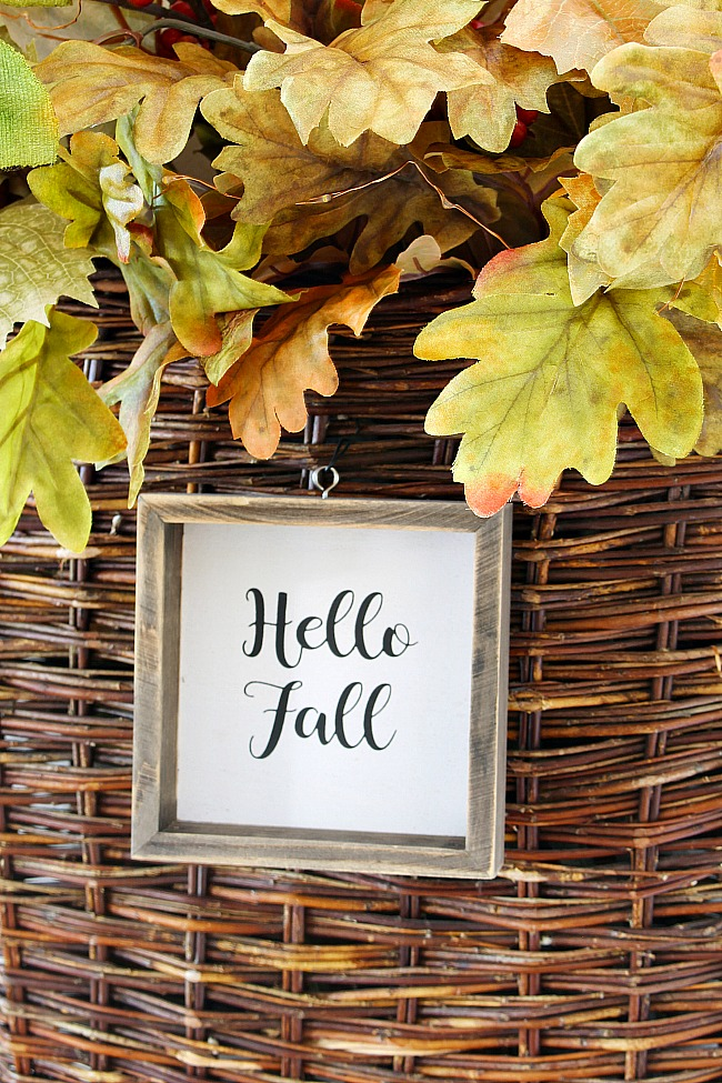 Wooden Hello Fall sign attached to a DIY fall wreath.