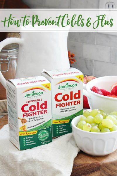 How to prevent colds and flus. Jamieson cold fighter supplements with bowls of grapes and strawberries.
