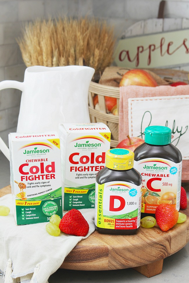 How to prevent colds and flus. Jamieson Cold Fighter bottles along with vitamin D and vitamin C.