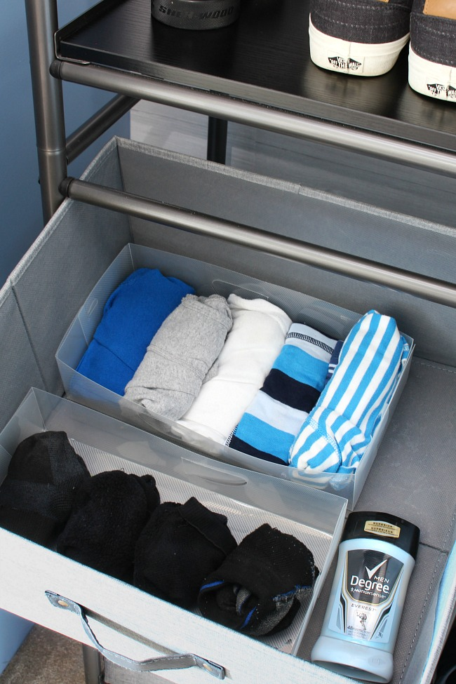 Clothes organizer system with drawer units.