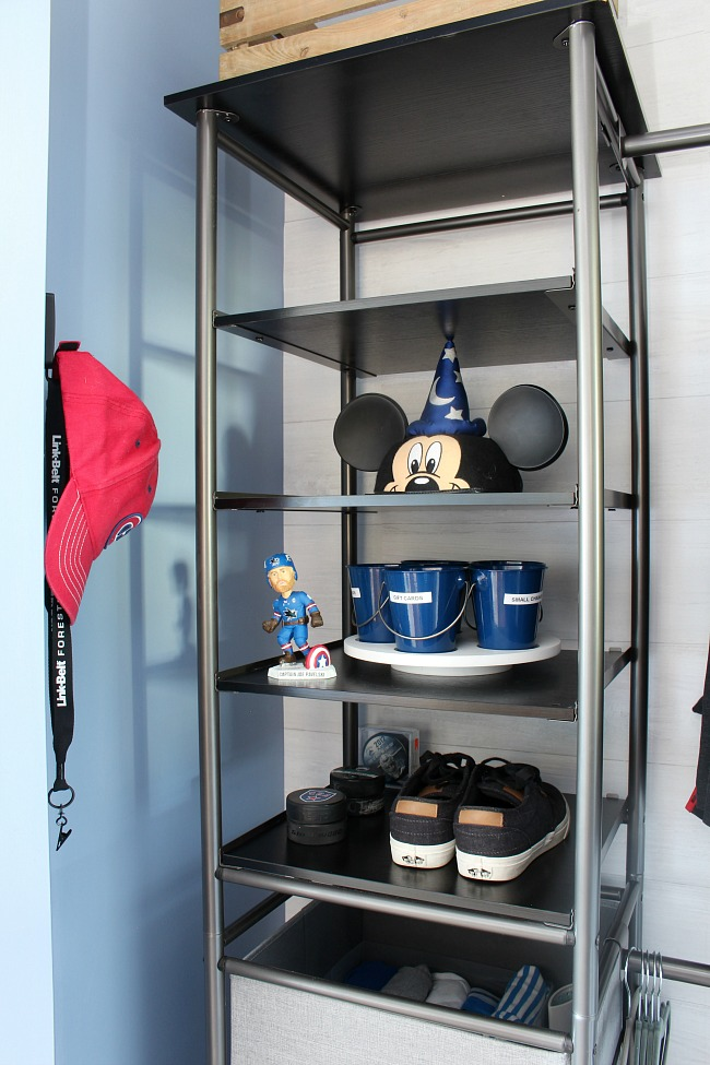 Closet organizer with shelves on the top for added storage and display items.
