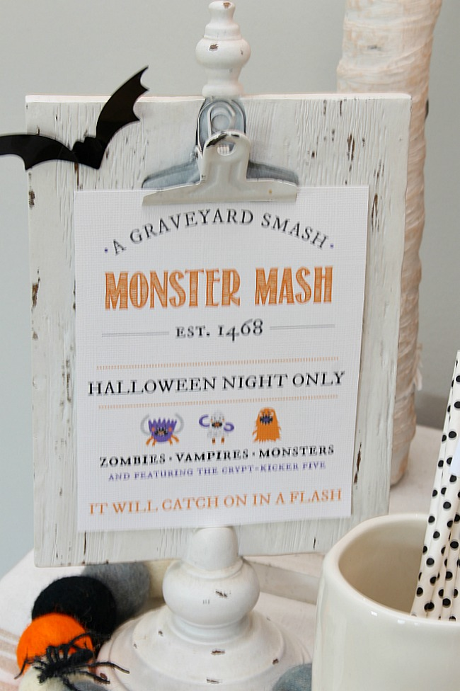 Monster Mash Halloween printable displayed on a clipboard.