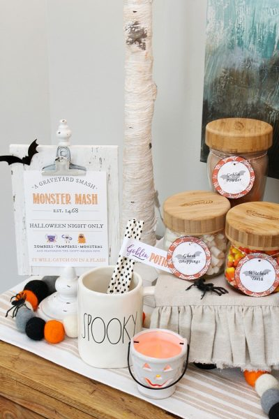 Halloween hot chocolate bar in mason jars with free Halloween labels.