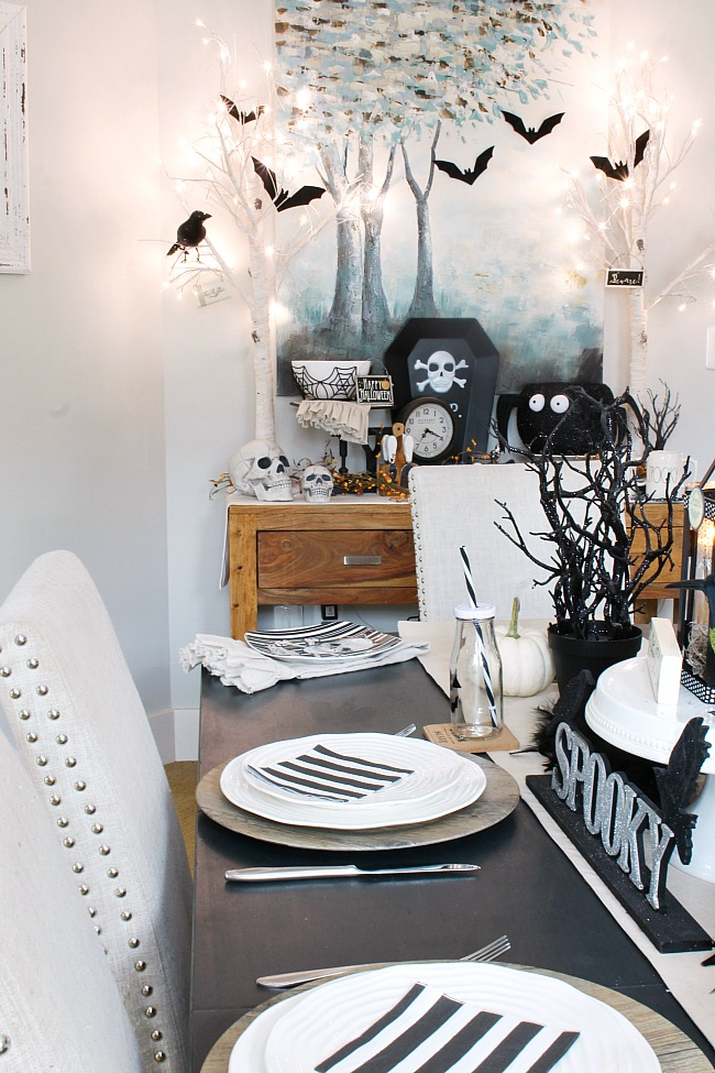 Halloween decor ideas. Halloween table decorated with black and white Halloween decor.
