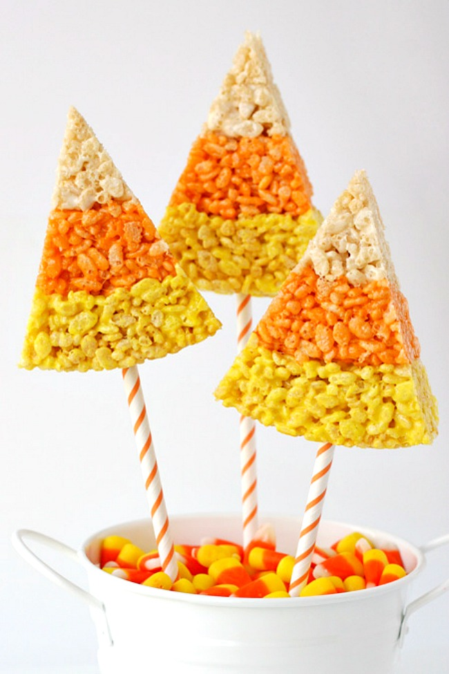 Rice Krispie treats on a stick shaped like candy corn.