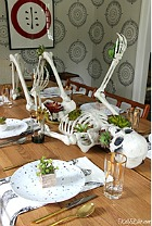 Halloween tablescape with skeletons and succulents.