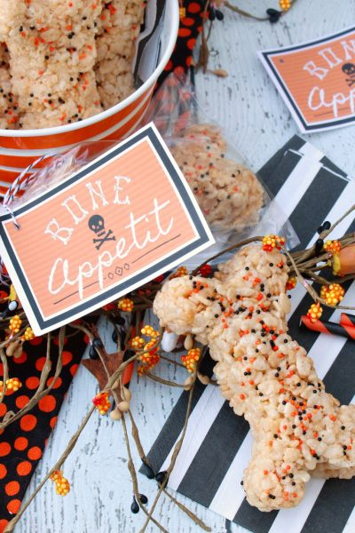 Rice Krispie treats shaped as bones for a Halloween treat with Bone Appetit Halloween gift tag.