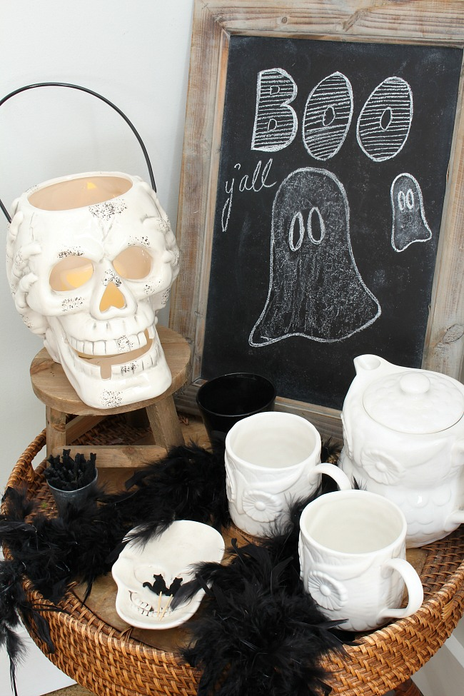 Black and white Halloween decor ideas with a simple hot beverage station and Halloween chalkboard.